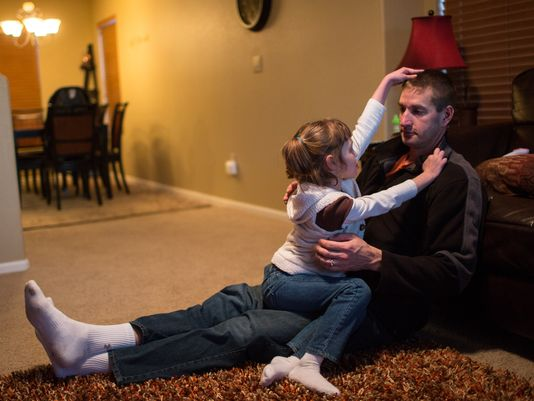Mark Botker plays with daughter Greta, 7, at their new Colorado home. Greta is prescribed cannabis oil for severe seizures. The oil is extracted from a genetically modified strain of marijuana called Charlotte's Web. (Photo: Nathan Armes for USA TODAY)