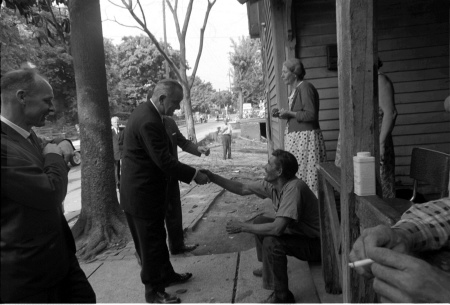 President Lyndon B. Johnson shakes the hand of one of the residents of Appalachia in 1964 as he launched his War on Poverty. (Cecil Stoughton, LBJ Library)